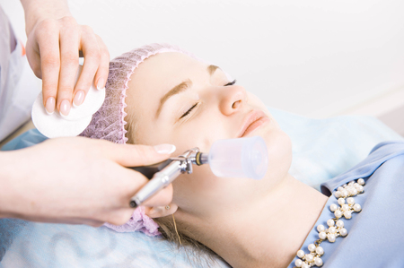 Cosmetologist performs the rejuvenation procedure Stock Photo