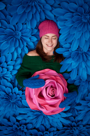 Beautiful girls with giant decorative flowers