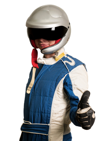 Professional formula pilot wearing a racing suit for motor sports. Thumbs up.