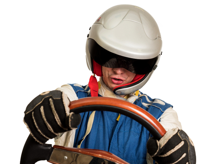 Race car driver in the helmet while driving. On a white background