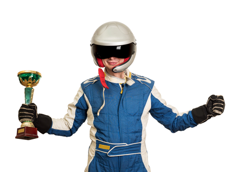 Portrait of a male racer winner with a gold trophy cup isolated on white Фото со стока