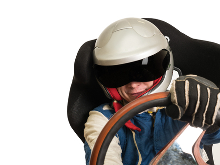 Race car driver in the helmet while driving.