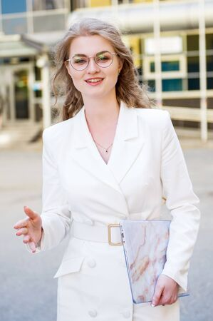 Portrait of a smiling business woman in glasses