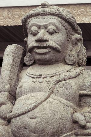 medium shot: balinese stone statue guardian medium shot