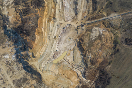 Aerial view of an open mine pit. Exploitation and nature pollution