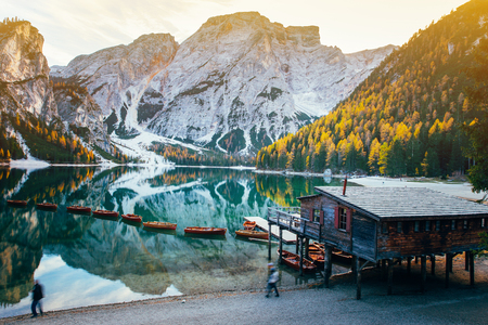 Autumn at Braies lake, Italy. Famous lake in the Dolomites. Stock fotó