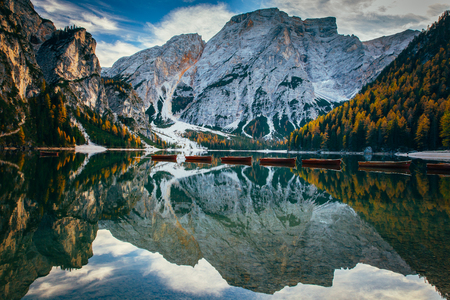 Autumn at Braies lake, Italy. Famous lake in the Dolomites. Stock Photo