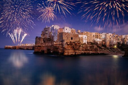 Fireworks celebrations in Polignano a Mare, Italy. New years eve and festival concept.