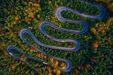 Scenic curvy road seen from a drone in autumn. Cheia, Romania.