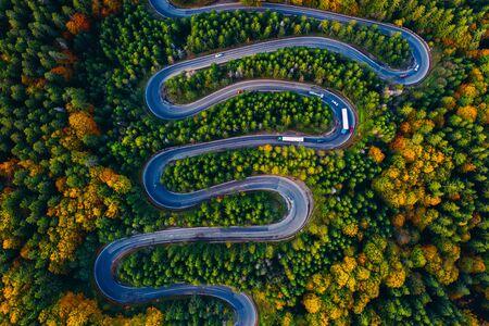 Scenic curvy road seen from a drone in autumn. Cheia, Romania.