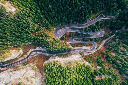 Drone view of winding forest road in the middle of Bicaz Gorge, Transylvania