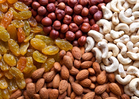 Four section of different nuts and raisins