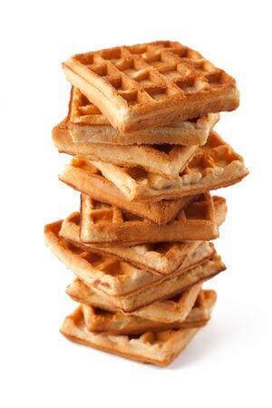 Big pile of fresh Belgian waffles on a white background Stock Photo