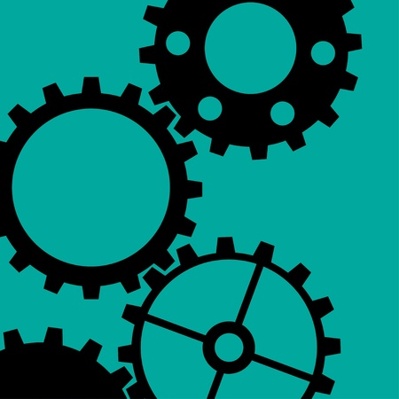Four different black gear wheels on a green background