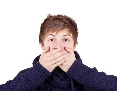 kokhalzen: Boy sloot zijn mond met zijn handen Stockfoto