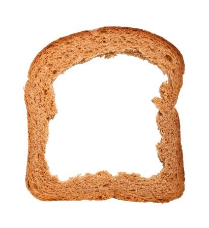 levadura: Mendrugo de pan aislado en el fondo blanco