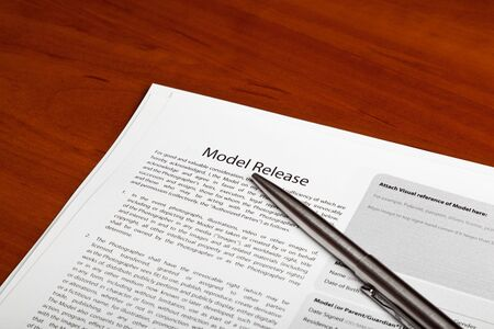 Several model release forms are on the table Stock Photo