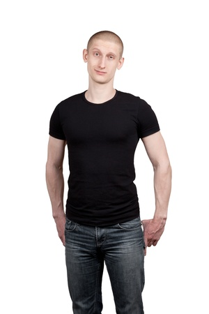 to tight: Athletic young man in jeans and t-shirt isolated on white background Stock Photo