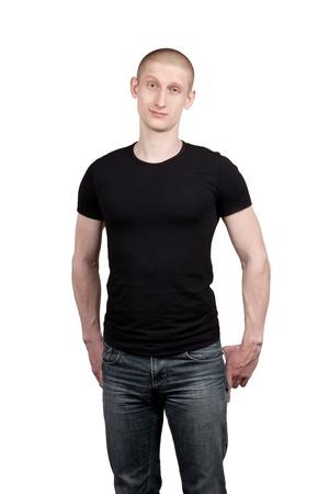 jeans apretados: Hombre atlético joven en vaqueros y camiseta aisladas sobre fondo blanco