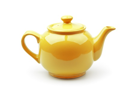 Bright orange teapot isolated on white background photo