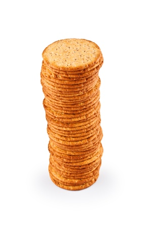 The high pile of delicious salty crackers isolated on white background