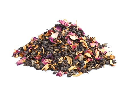 Elite green tea with candied fruit and rose petals on white background