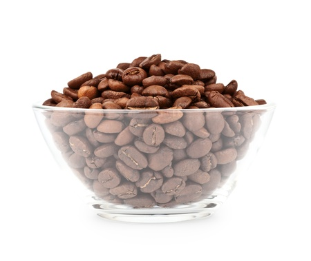 Glass bowl with roasted coffee beans isolated on white background