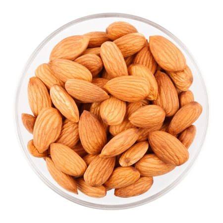 Bowl with dried almonds isolated on a white background Stock Photo