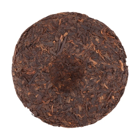 Pressed Chinese puer tea isolated on a white background photo