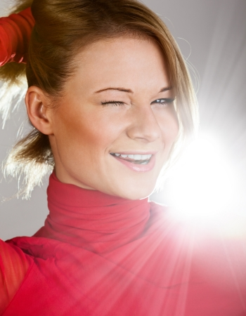 Laughing girl in a red turtleneck closeup