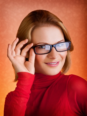 Closeup portrait of a stylish young woman in glasses