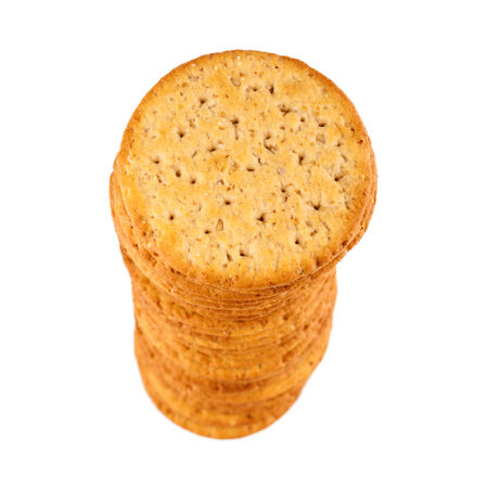 Stack of saltine crackers, top view  Shallow depth of field, isolation on white