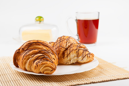 Two croissant and a cup of black tea  Shallow depth of field photo