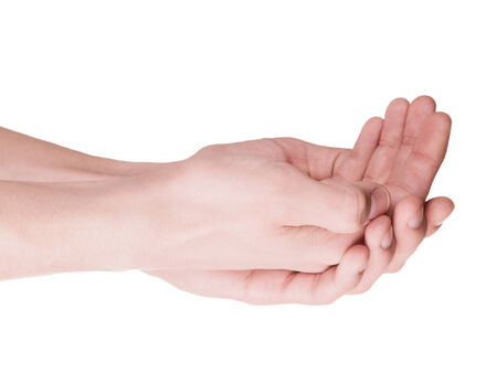 poorness: Cupped hands of a young man closeup  Isolation on white
