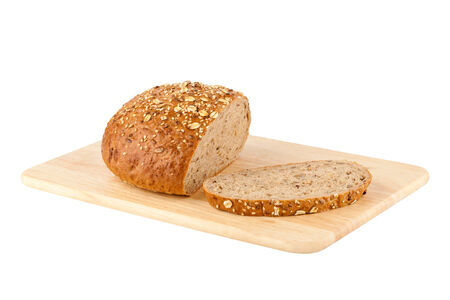 Sliced loaf of homemade bread on a wooden cutting board Stock Photo