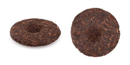 A disc of pressed puer tea on white background side and top view photo