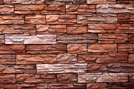 The texture of the red stone wall