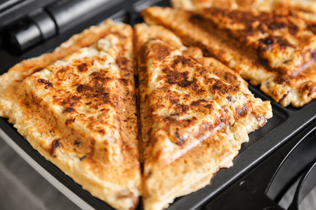 Unusual use of the sandwich maker: cooking healthy cottage cheese pancakes with raisins