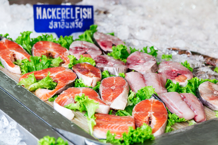 The counter with fresh mackerel and other seafood at a street market in Pattaya, Thailand