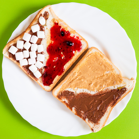 spreads: Delicious sandwich with a variety of spreads on a white plate for breakfast