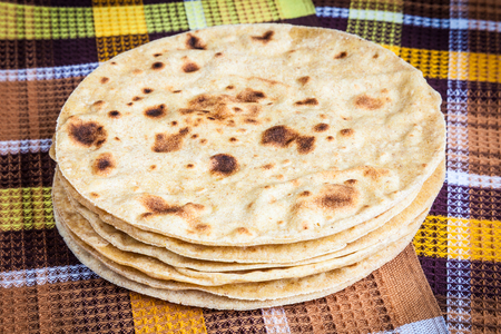 Freshly baked Mexican tortillas laid out on a towel Stock Photo
