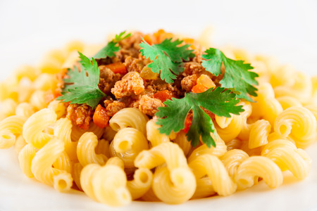 Pasta served with bolognese sauce. Traditional Italian food. Close-up, very shallow depth of field
