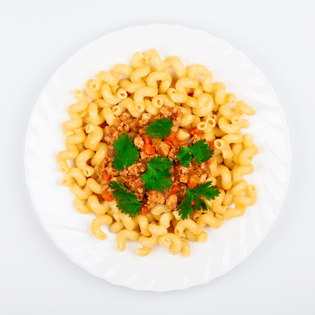 A plate of pasta with Bolognese sauce, top view. Traditional Italian food Stock Photo