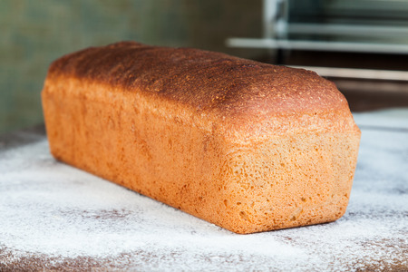 A whole loaf of freshly baked homemade wheat bread