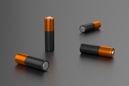 A few AA or AAA batteries on gray background Stock Photo