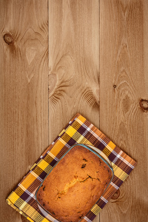 Freshly baked homemade cake on wooden background, top view Stock Photo