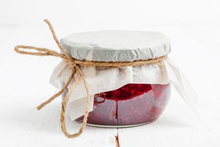 Small jar of homemade jam close-up, shallow depth of field Stock Photo