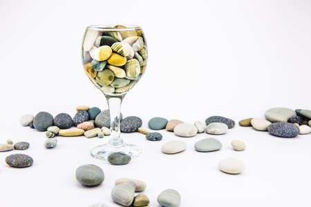 Glass with ocean rocks on white background Stock Photo