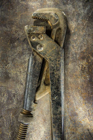 alligator wrench: alligator wrench on metal background