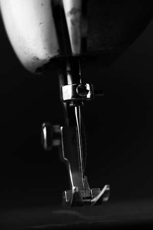 Old Sewing Machine - macro photo background - industry